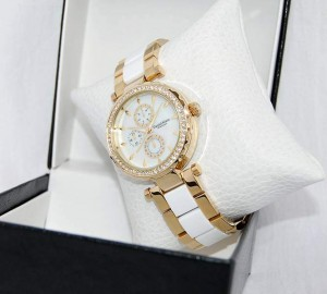 Classic colors are yellow and white wristwatch created for women