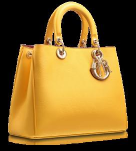 Külçe altın rengi ve tipinde bayan kol çantası